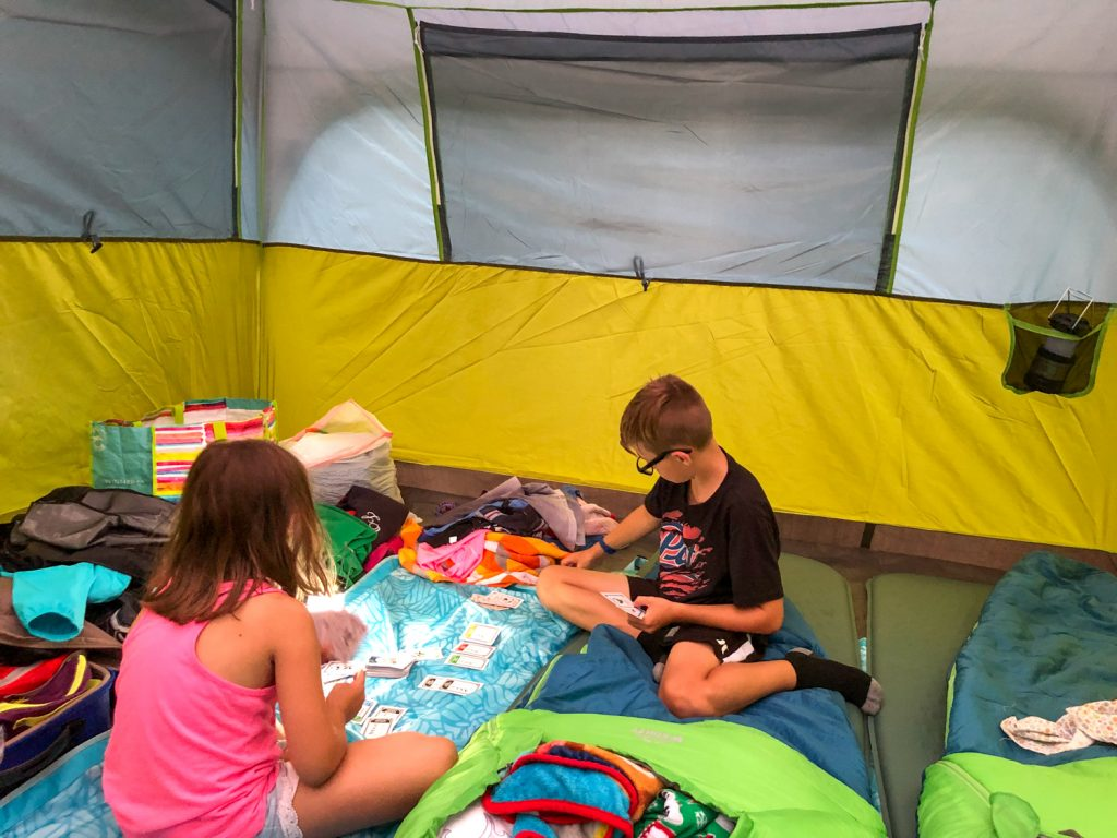 Camping with Kids Checklist: The Ultimate Family Camping Packing List with everything that you need to pack for your next family camping trip. An easy and simple list to help you pack for camping with the kids. A simple checklist that is PRINTABLE from a family that camps in a tent, trailer, RV, cabins and more! #camping #campingchecklist #campingpackinglist #kidscamping #familycamping