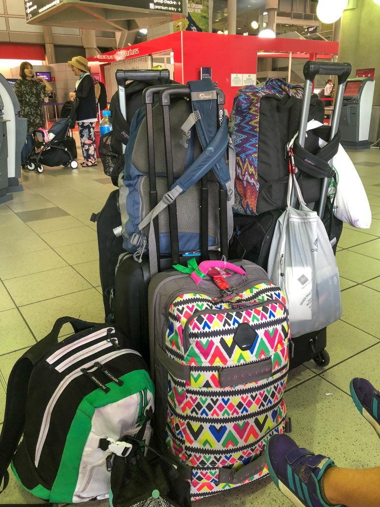 Looking for a long-term travel checklist? Here is the exact packing list we used for 1 year of full-time family travel. Includes a FREE printable packing checklist to ensure you bring the essential items for long term travel. One-bag family travel packing! Plus, packing tips for long trips to make it easy! #fulltimetravel #packinghacks #packingfamily #longtermpacking #travellongterm #packingtip #packingvacation